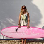 JNR Custom Surfboards, happy client with her mid length surfboard in pink